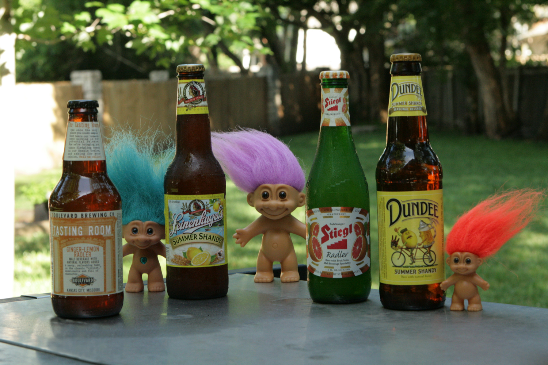 Premade craft beer vs homemade summer shandy and radler varieties in bottles.