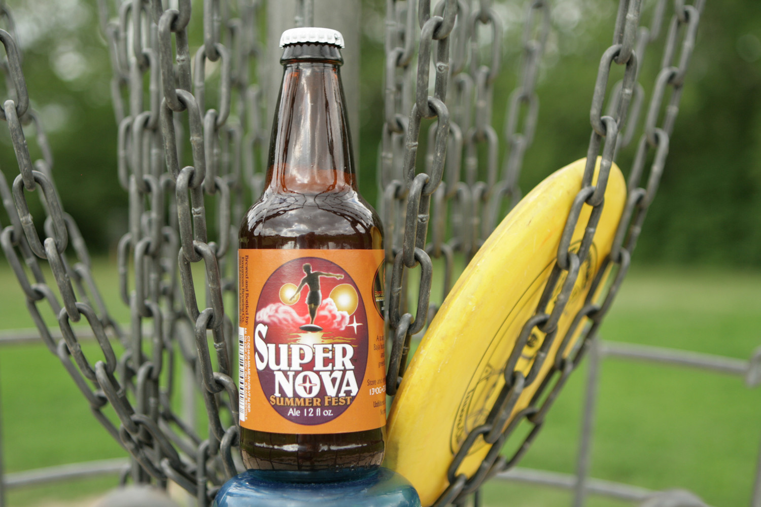 Find Super Nova summer beer on the disc golf course.
